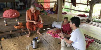 monk receives Bible