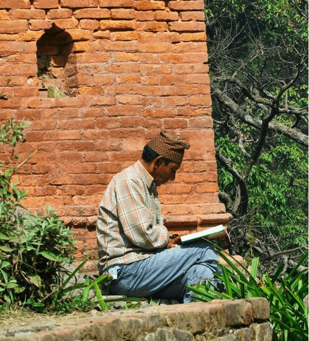 Man reading a Bible in the jungle